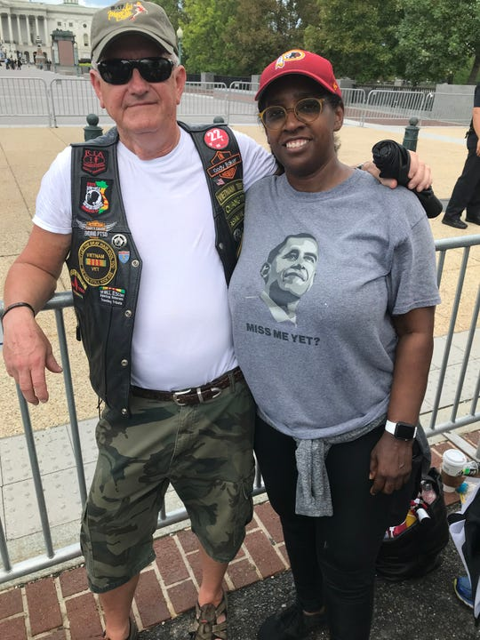 Gary Galloway and Tori Prudhomme-Yurochko struck up a friendship waiting to pay their respects to Sen. John McCain at the U.S. Capitol in Washington, D.C., Aug. 31, 2018.
