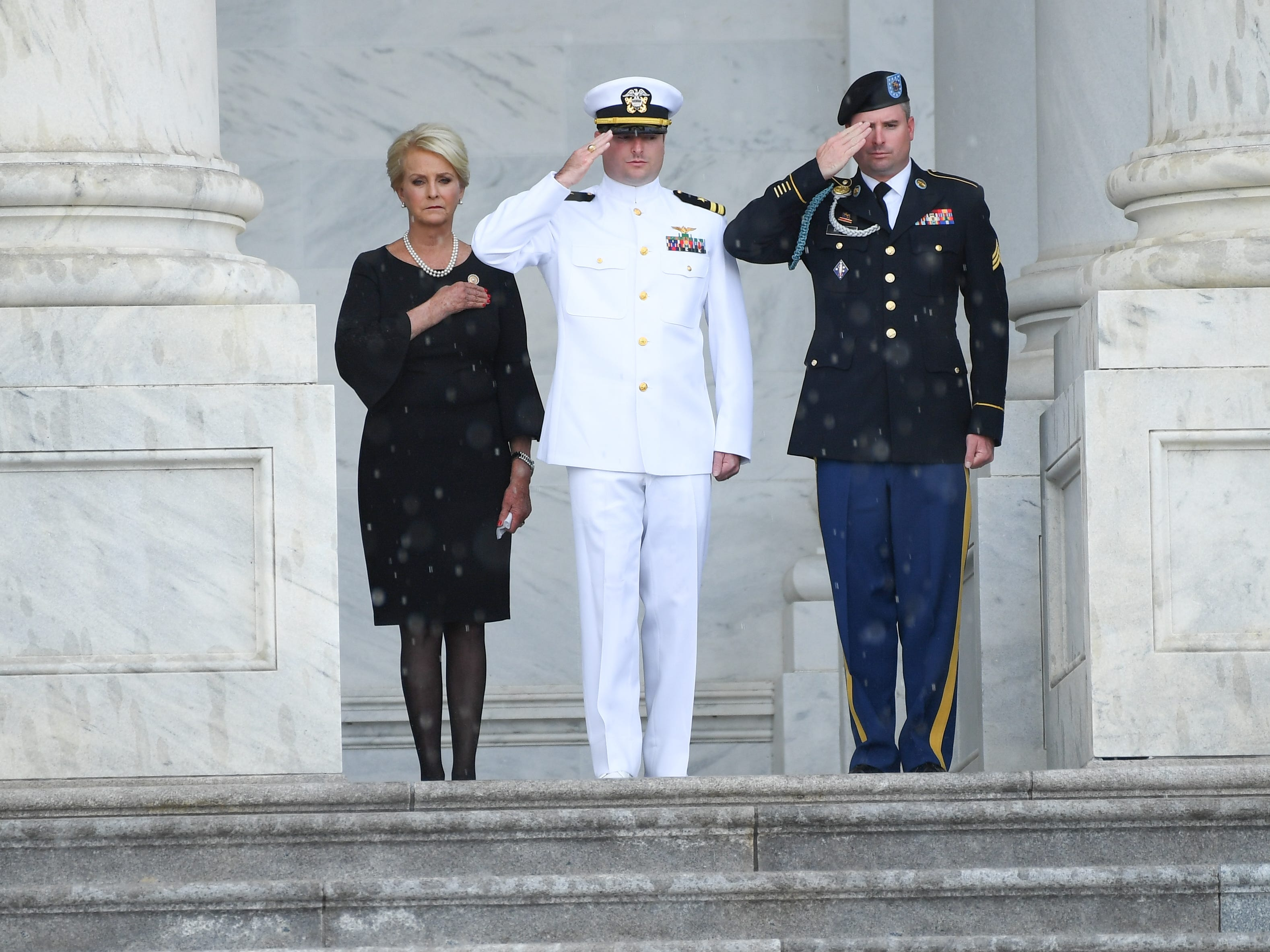 8/31/18 10:43:21 AM -- Washington, DC, U.S.A  -- The casket of John McCain arriving at the U.S. Capitol while his wife Cindy McCain watching along with her two sons Jack and Jimmy McCain at the U.S. Capitol in Washington on Aug. 31, 2018 in Washington. Sen. McCain died on Aug. 25. --    Photo by Jack Gruber, USA TODAY Staff ORG XMIT:  JG 137435 McCain U.S. Capi 8/31 (Via OlyDrop)
