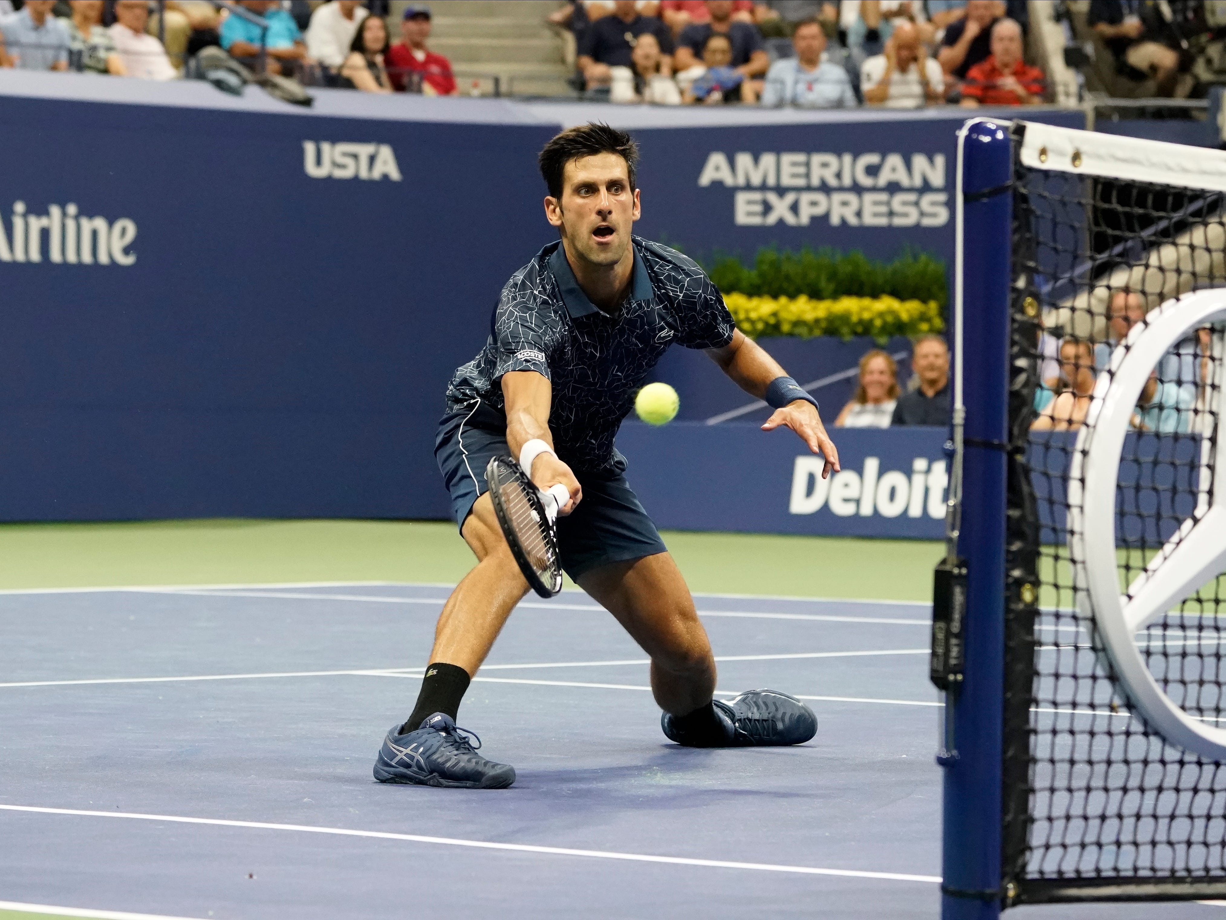 Novak Djokovic of Serbia chases one down at the net during his  6-1, 6-3, 6-7(2), 6-2 win against Tennys Sandgren of the USA.