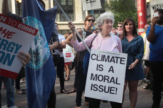 Demonstrators protest President Donald Trump's decision to exit the Paris climate change accord on June 2, 2017 in Chicago, Illinois.