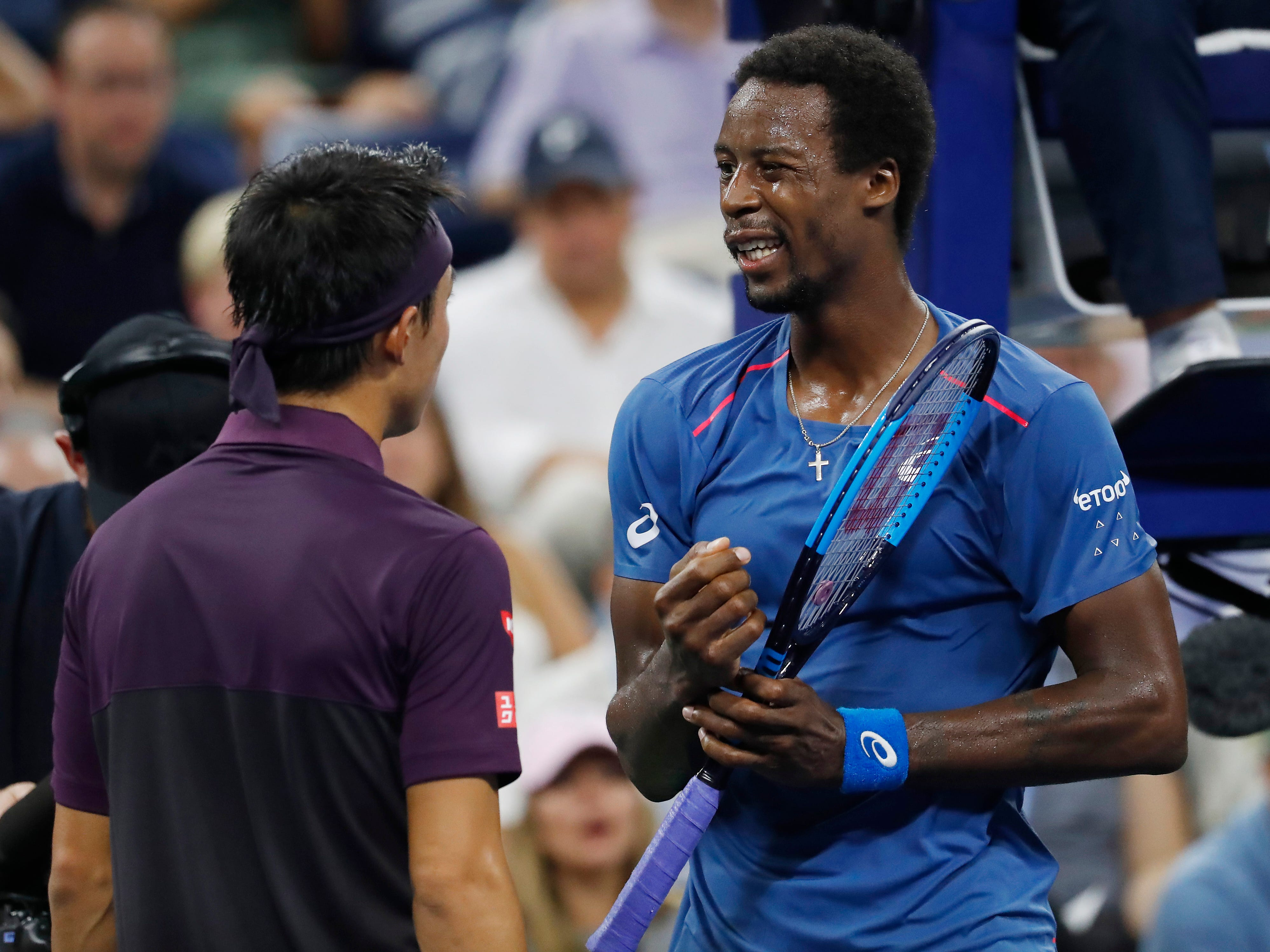 Gael Monfils (right) of France was foreced to retire against Kei Nishikori of Hapan because of a wrist injury.
