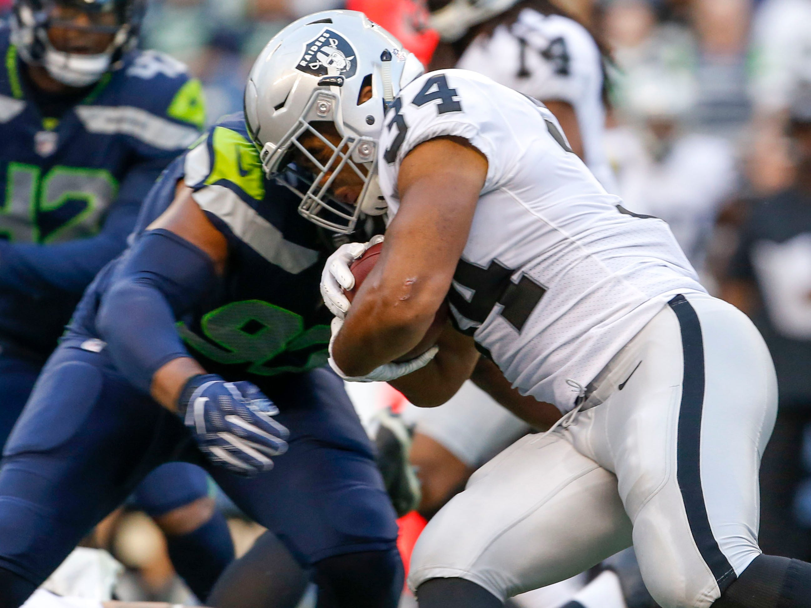 Seattle Seahawks defensive tackle Nazair Jones stops Oakland Raiders running back Chris Warren for a loss during the first quarter at CenturyLink Field.