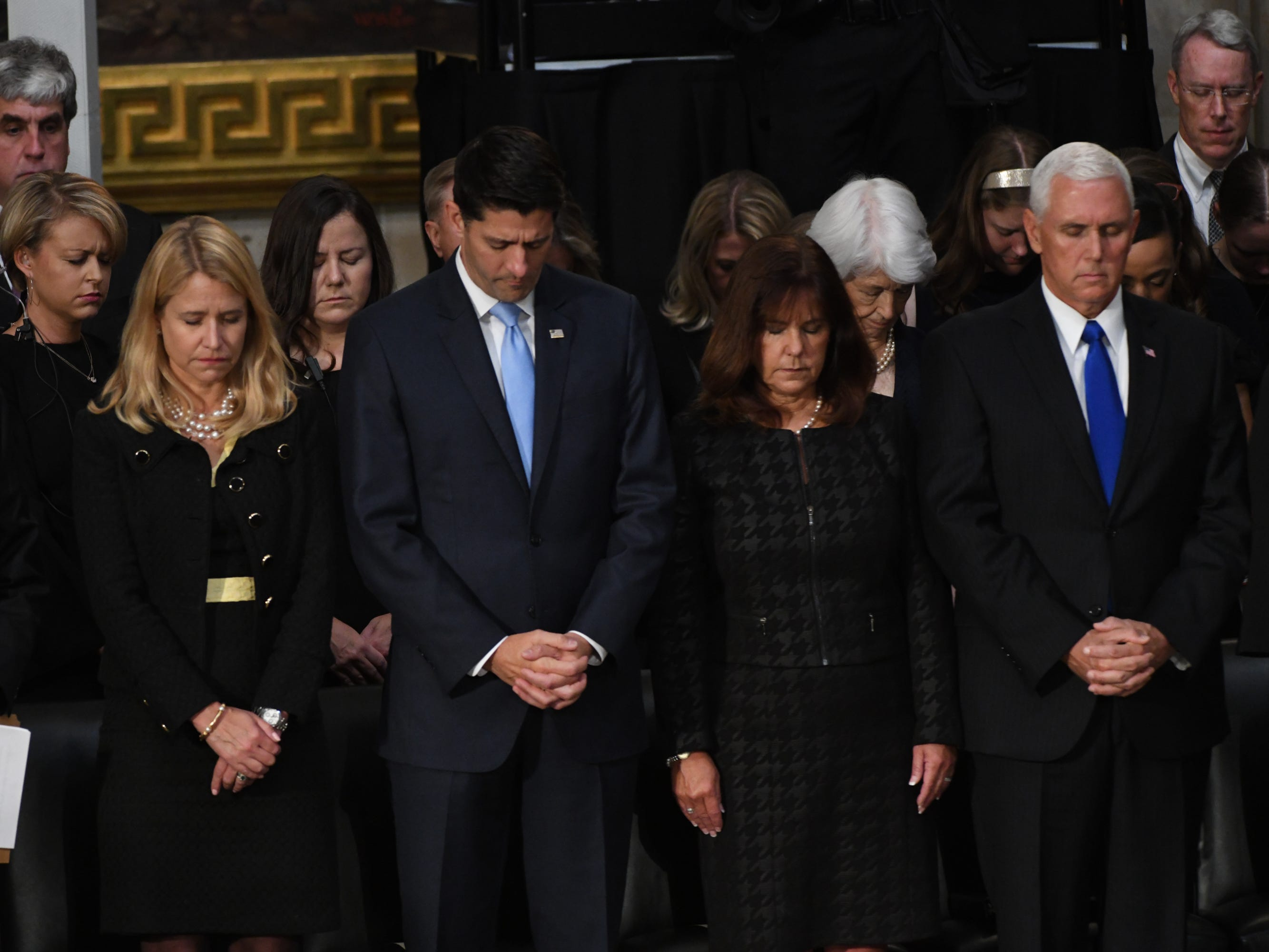 8/31/18 10:55:38 AM -- Washington, DC, U.S.A  -- Sen. Mitch McConnell, Janna and Speaker of the House Paul Ryan, and Vice President Mike Pence stand in prayer as the body of John McCain lies in state at the U.S. Capitol in Washington on Aug. 31, 2018 in Washington. Sen. McCain died on Aug. 25. --    Photo by Jasper Colt, USA TODAY Staff ORG XMIT:  JC 137436 McCain U.S. Capi 8/31/2018 (Via OlyDrop)