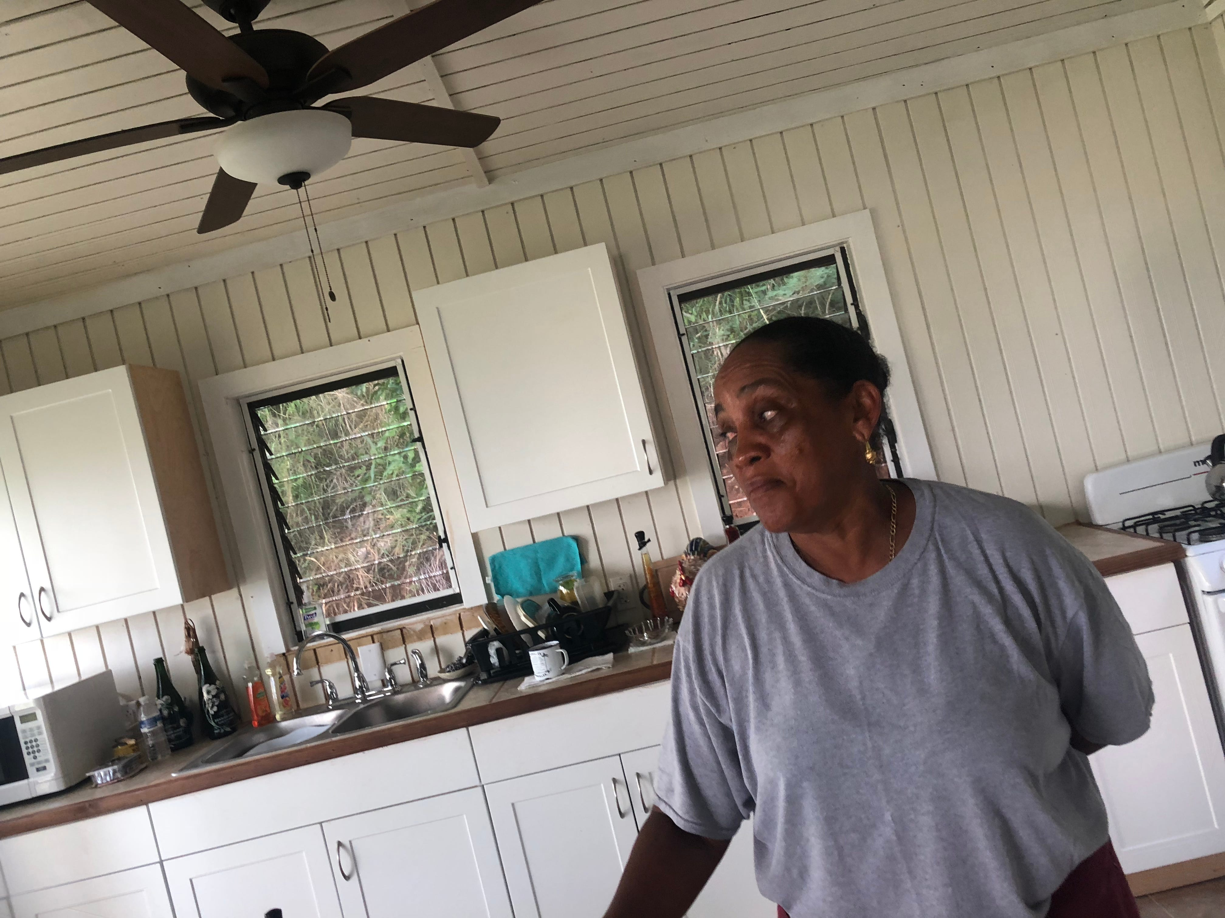 Evelyne Stephen, 61, inside the new two-bedroom home built by Love for Love City, one of the private groups helping to rebuild St. John. Stephen received $11,000 from FEMA but it wasnÕt enough to replace her home, which was destroyed by Hurricane Irma.