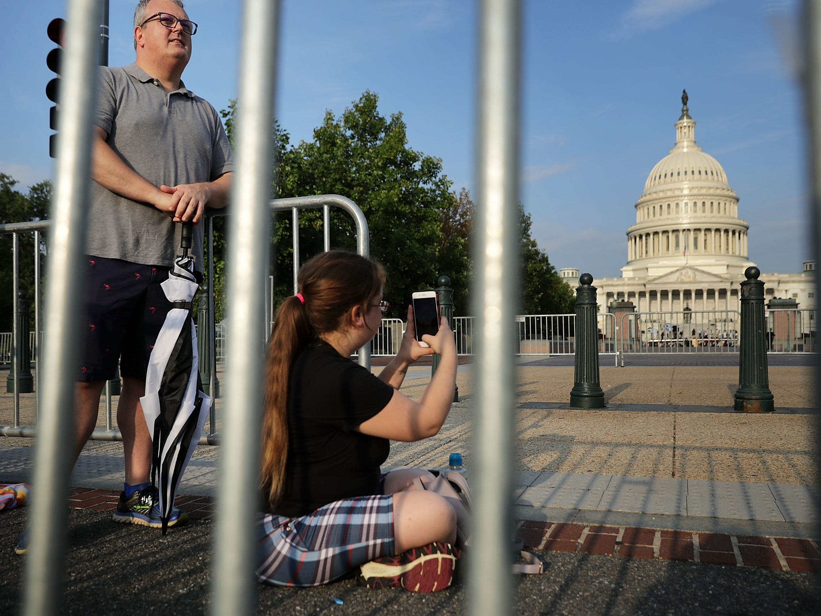 "WASHINGTON, DC - AUGUST 31:  Brian Erdelyi (L) of Richmond, Virginia, and AnnMarie Farone of Indianapolis, Indiana, are first in line to pay respects to Sen. John McCain (R-AZ) when he lies in state later in the dat at the U.S. Capitol August 31, 2018 in Washington, DC. Erdelyi said he came to pay respects to McCain because he ""showed a lot of integrity, which is sorely missing today."" The late senator died August 25 at the age of 81 after a long battle with brain cancer. He will lie in state at the U.S. Capitol Friday, a rare honor bestowed on only 31 people in the past 166 years. Sen. McCain will be buried at his final resting place at the U.S. Naval Academy on Sunday.  (Photo by Chip Somodevilla/Getty Images) ORG XMIT: 775217654 ORIG FILE ID: 1025510134"