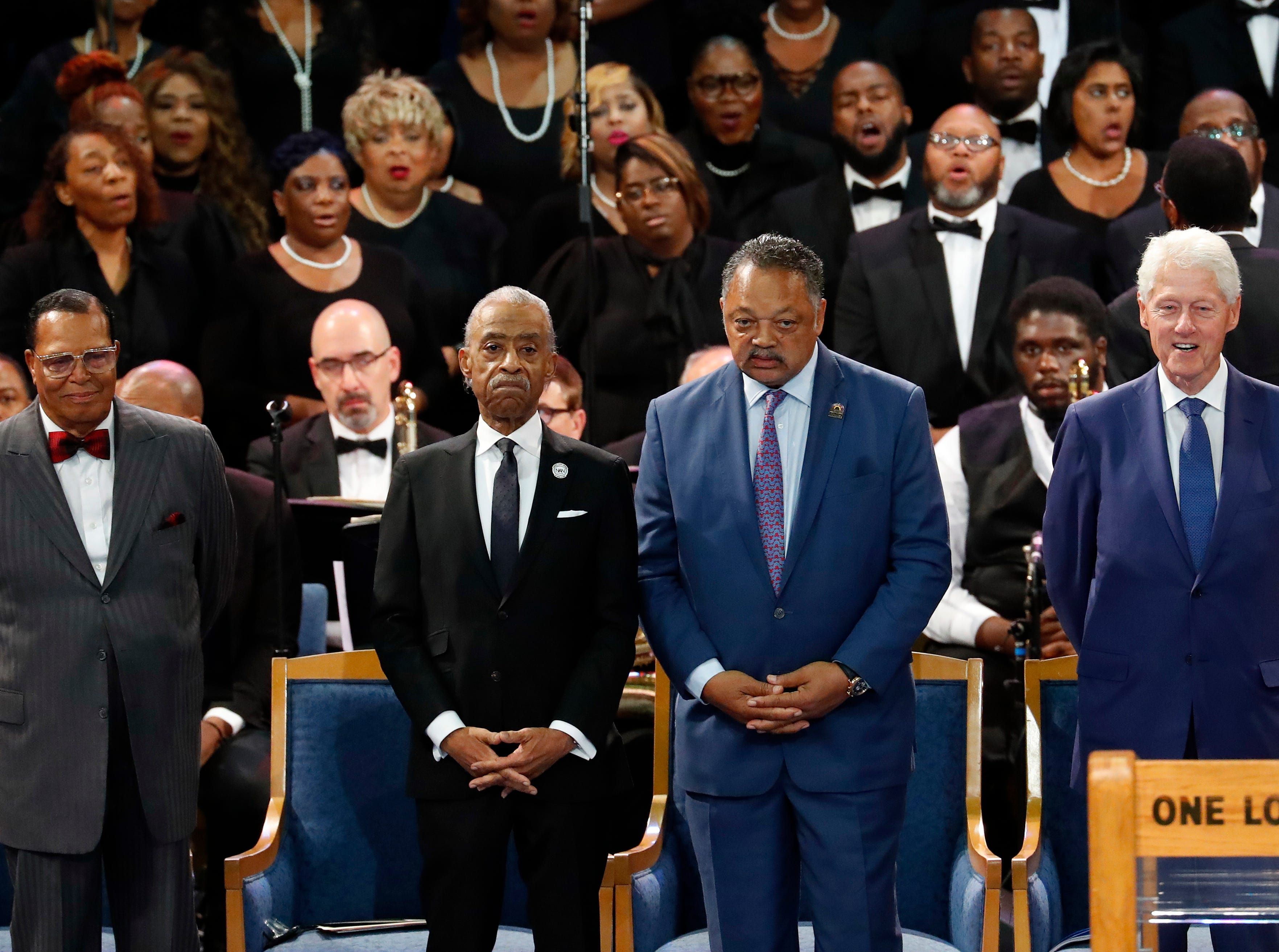 Louis Farrakhan, from left, Rev. Al Sharpton, Rev. Jesse Jackson and former President Bill Clinton attend the funeral service for Aretha Franklin at Greater Grace Temple, Friday, Aug. 31, 2018, in Detroit. Franklin died Aug. 16, 2018 of pancreatic cancer at the age of 76. (AP Photo/Paul Sancya) ORG XMIT: MIJR101