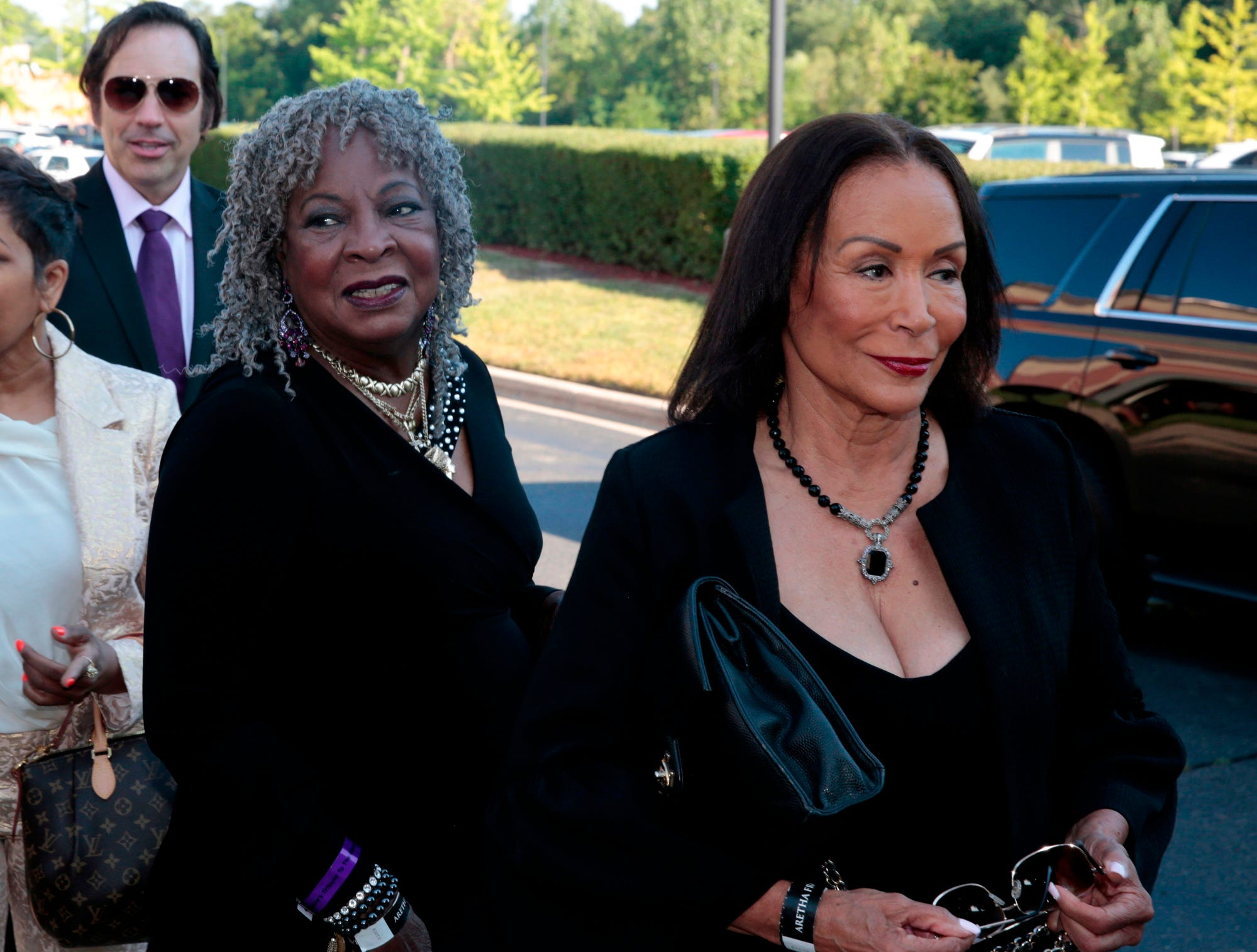 Motown artist Martha Reeves, 2nd right, and Freda Payne, right, arrive for Aretha Franklin's funeral at the Greater Grace Temple on Friday.
