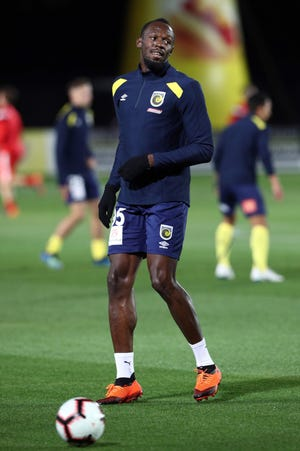 Olympic sprinter Usain Bolt warms up before he plays for A-League football club Central Coast Mariners in a pre-season practice match against a Central Coast amateur selection team in Gosford, New South Wales on August 31, 2018.