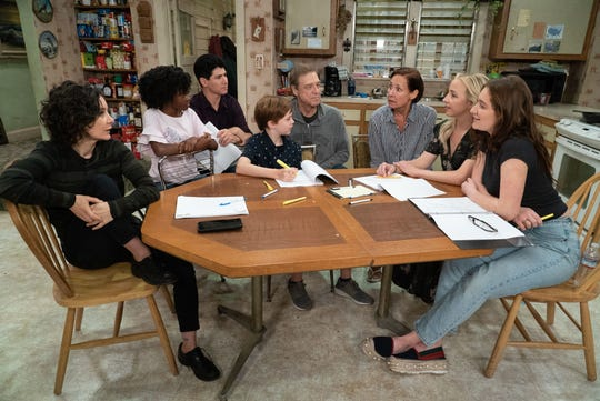 """The cast of """"The Conners"""" (left to right:) Sara Gilbert, Jayden Rey, Michael Fishman, Ames McNamara, John Goodman, Laurie Metcalf, Lecy Goranson and Emma Kenney."""