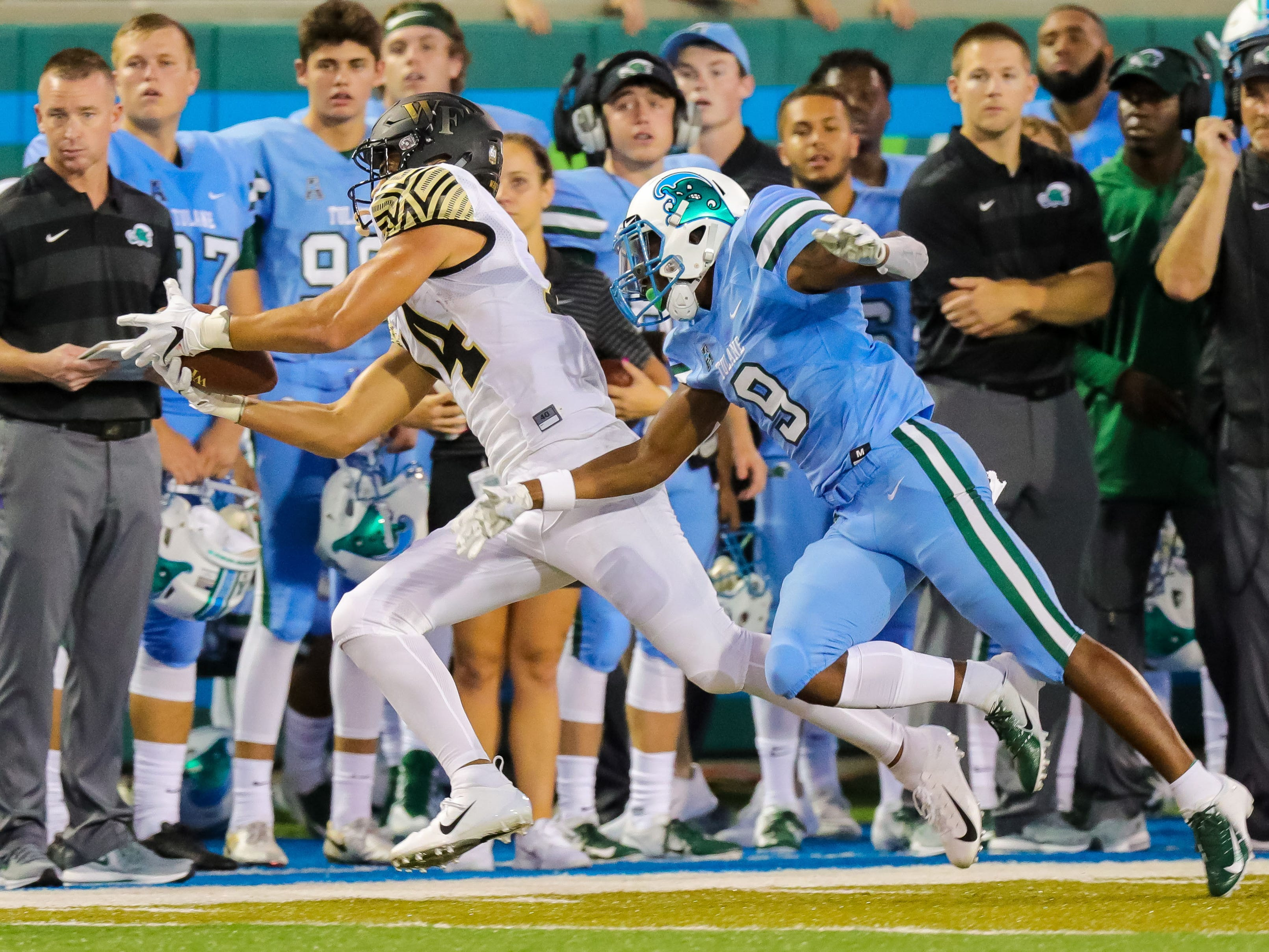 Wake Forest wide receiver Sage Surratt catches a 14-yard pass in the first quarter against Tulane cornerback Jaylon Monroe (9) at Yulman Stadium.