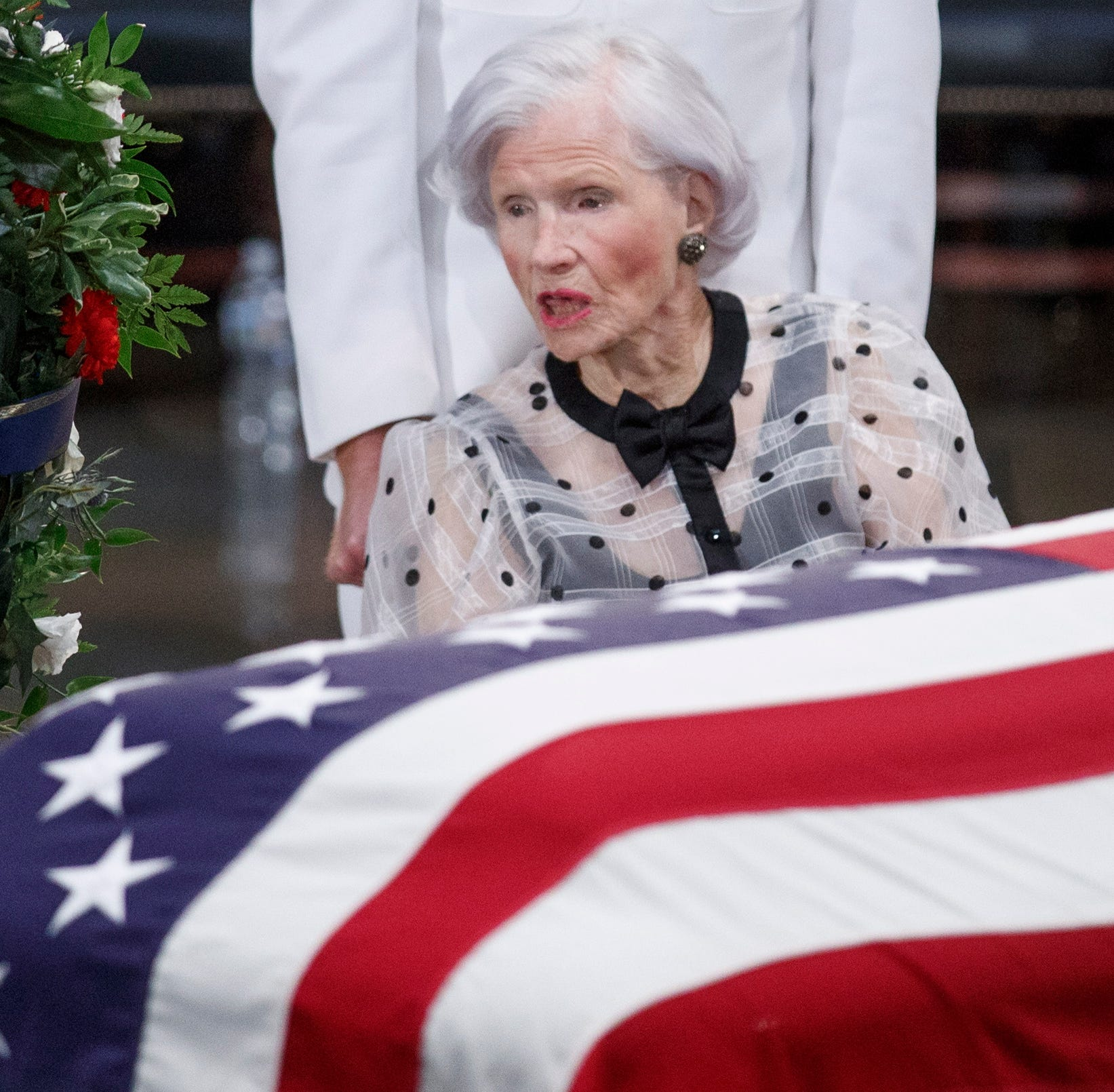Roberta McCain takes a moment at the casket of her son Sen. John McCain after a memorial service in the Rotunda, where he will lie in state for the rest of the day in Washington, D.C., on Aug. 31, 2018.