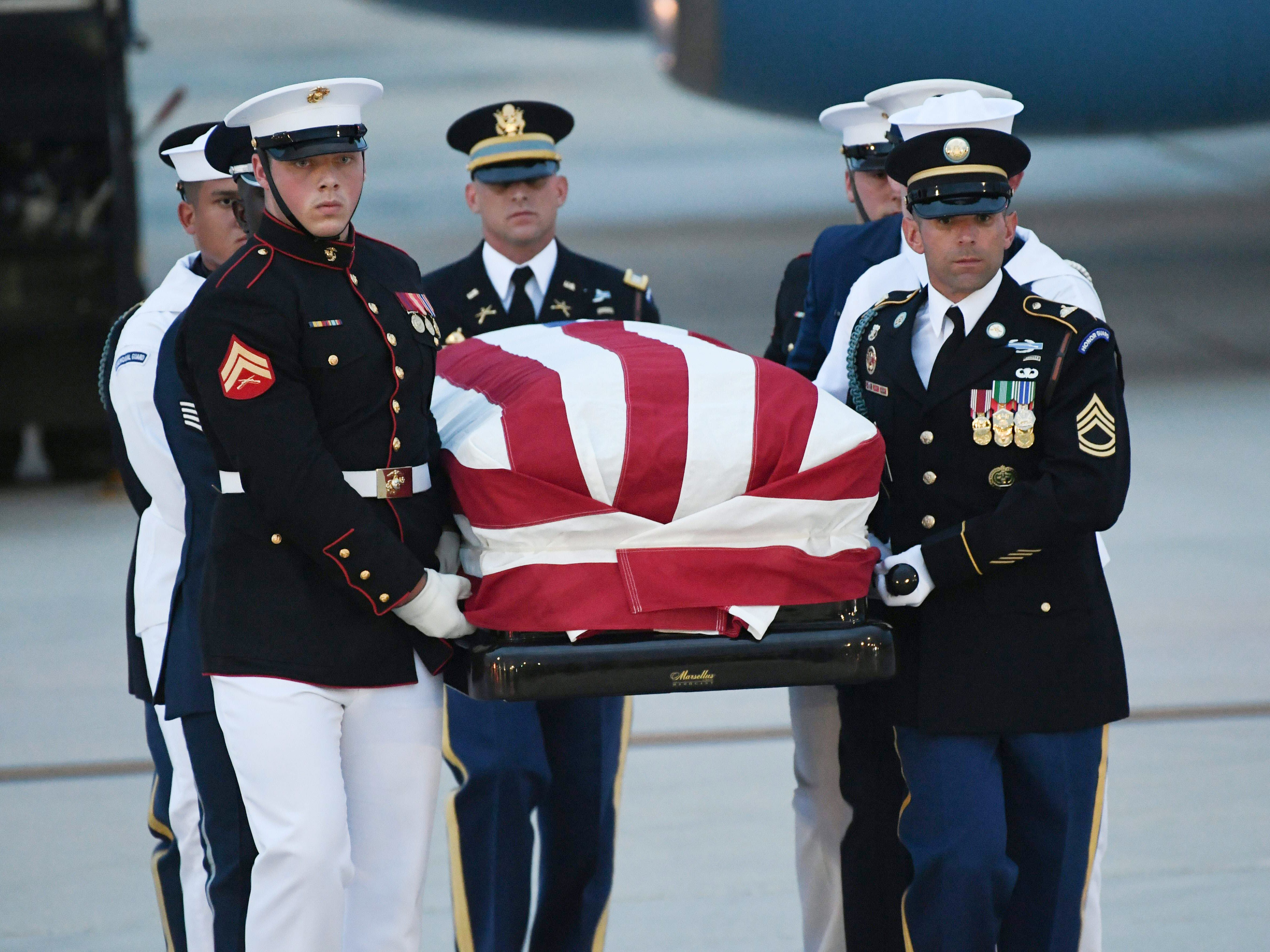 The flag-draped casket of the late US Senator John McCain, Republican of Arizona, arrives on a military airplane at Joint Base Andrews in Maryland, August 30, 2018. (Photo by SAUL LOEB / AFP)SAUL LOEB/AFP/Getty Images ORG XMIT: Senator J ORIG FILE ID: AFP_18Q461