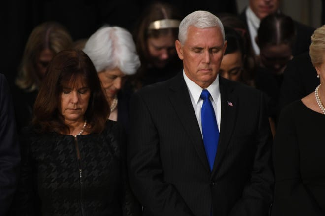 Aug 31, 2018; Washington, DC, USA;  Vice President Mike Pence and his wife Karen stand in prayer as the body of John McCain lies in state at the U.S. Capitol in Washington. Mandatory Credit: Jasper Colt-USA TODAY ORIG FILE ID:  20180831_jel_usa_103.jpg