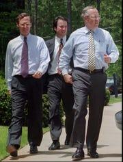 Brett Kavanaugh walks behind independent counsel Ken Starr, right, during the investigation of President Bill Clinton.