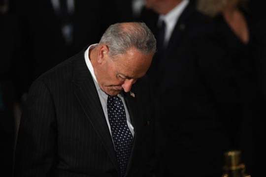 Sen. Chuck Schumer bows his head while waiting for the body of John McCain to lie in state at the U.S. Capitol in Washington on Aug. 31, 2018 in Washington.