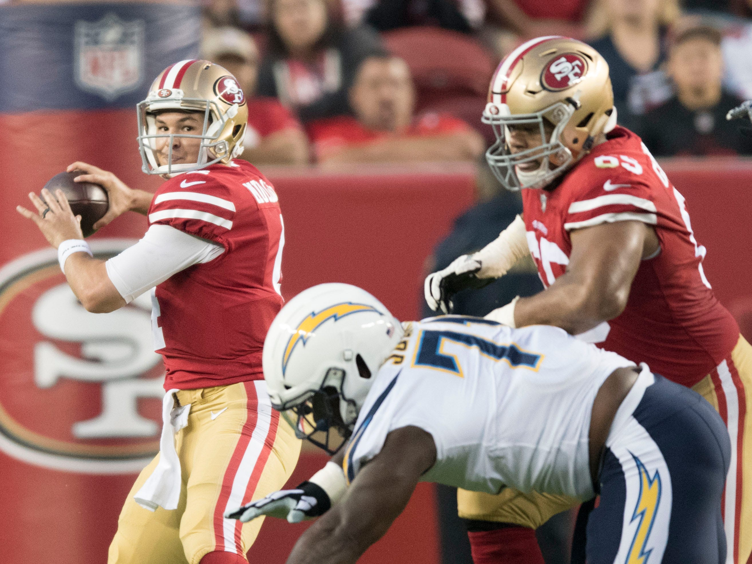 San Francisco 49ers quarterback Nick Mullens passes the football against the Los Angeles Chargers during the first quarter at Levi's Stadium.
