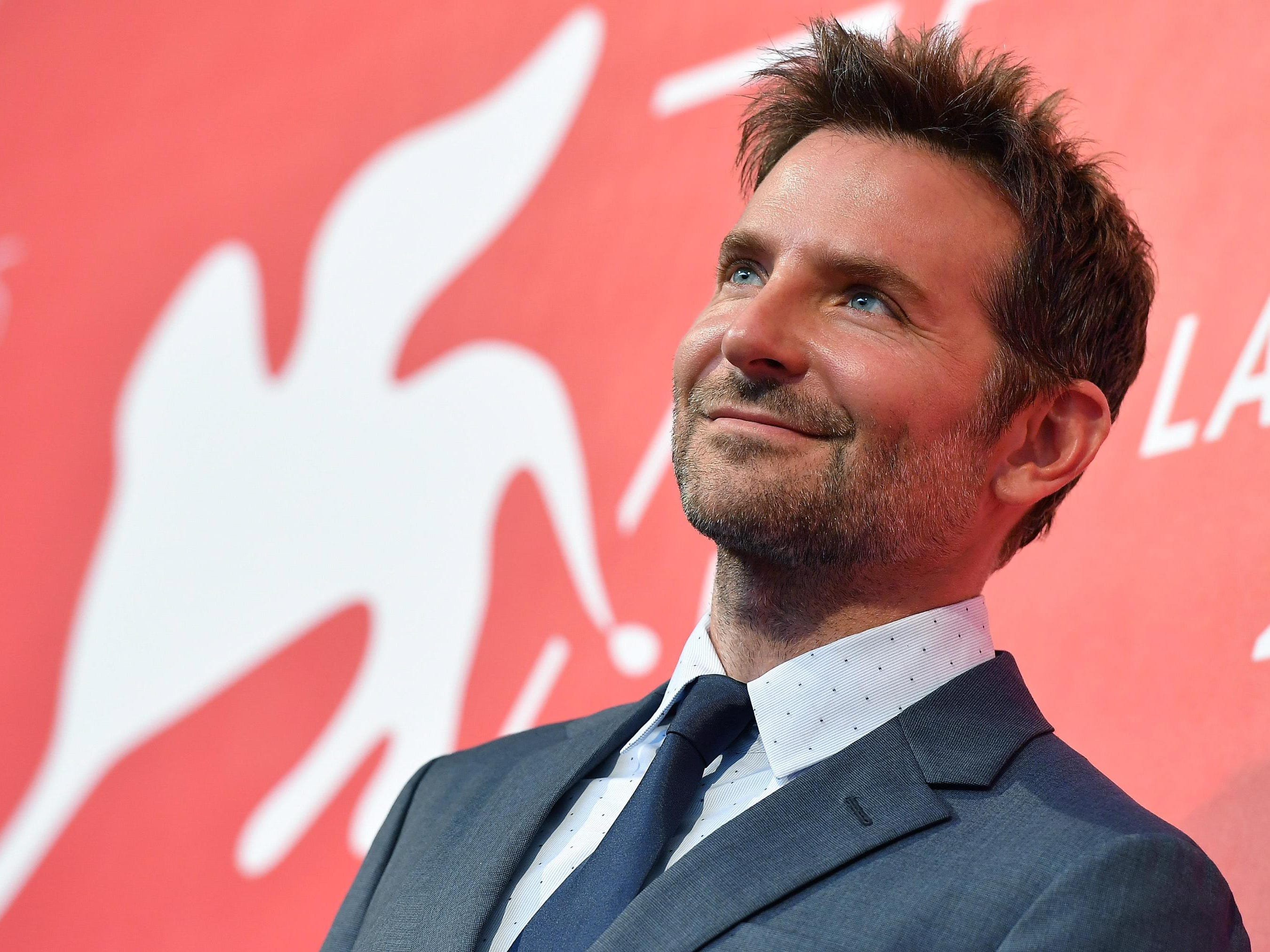 """Bradley Cooper, who stars in and directs """"A Star Is Born,"""" arrives for a photo call."""