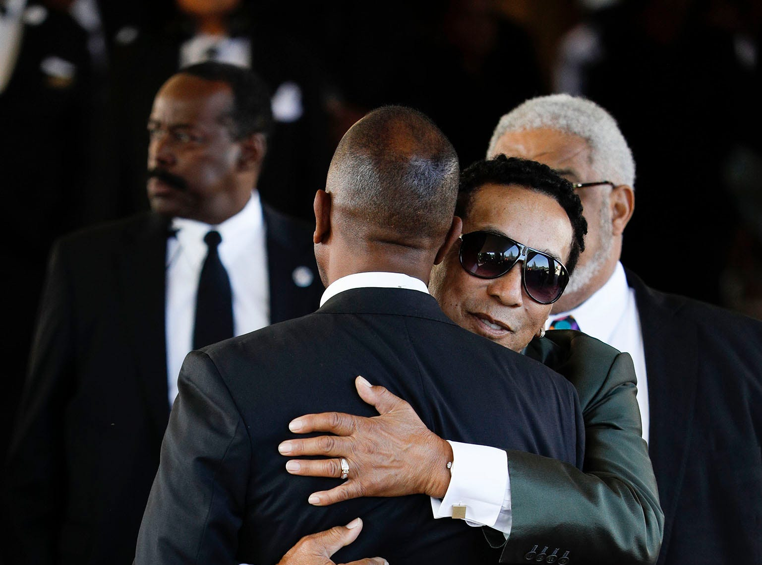 DETROIT, MI - AUGUST 31:  Smokey Robinson gives someone a hug as he enters Greater Grace Temple to attend soul music icon Aretha Franklin's funeral on August 31, 2018 in Detroit, Michigan. Dozens of musicians and dignitaries are scheduled to either speak or perform at the singer's funeral, including former President Bill Clinton, Stevie Wonder, Faith Hill, Ariana Grande, Chaka Khan, Smokey Robinson, Jennifer Hudson, and Cicely Tyson. (Photo by Bill Pugliano/Getty Images) ORG XMIT: 775217543 ORIG FILE ID: 1025523346