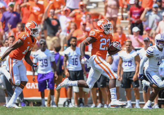 Clemson running back Lyn-J Dixon (23) breaks free for a long gain against Furman during the 3rd quarter Saturday, September 1, 2018 at Clemson's Memorial Stadium.