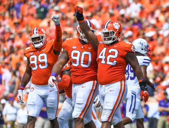 Clemson defensive lineman Clelin Ferrell (99), defensive lineman Dexter Lawrence (90) and defensive lineman Christian Wilkins (42) react after forcing a 4th down against Furman during the 1st quarter Saturday, September 1, 2018 at Clemson's Memorial Stadium.