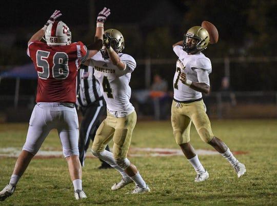 Pendleton senior Jamal Blakely throws near Palmetto junior Blake Chastain during the third quarter at Palmetto High School in Williamston on Friday, August 24, 2018.