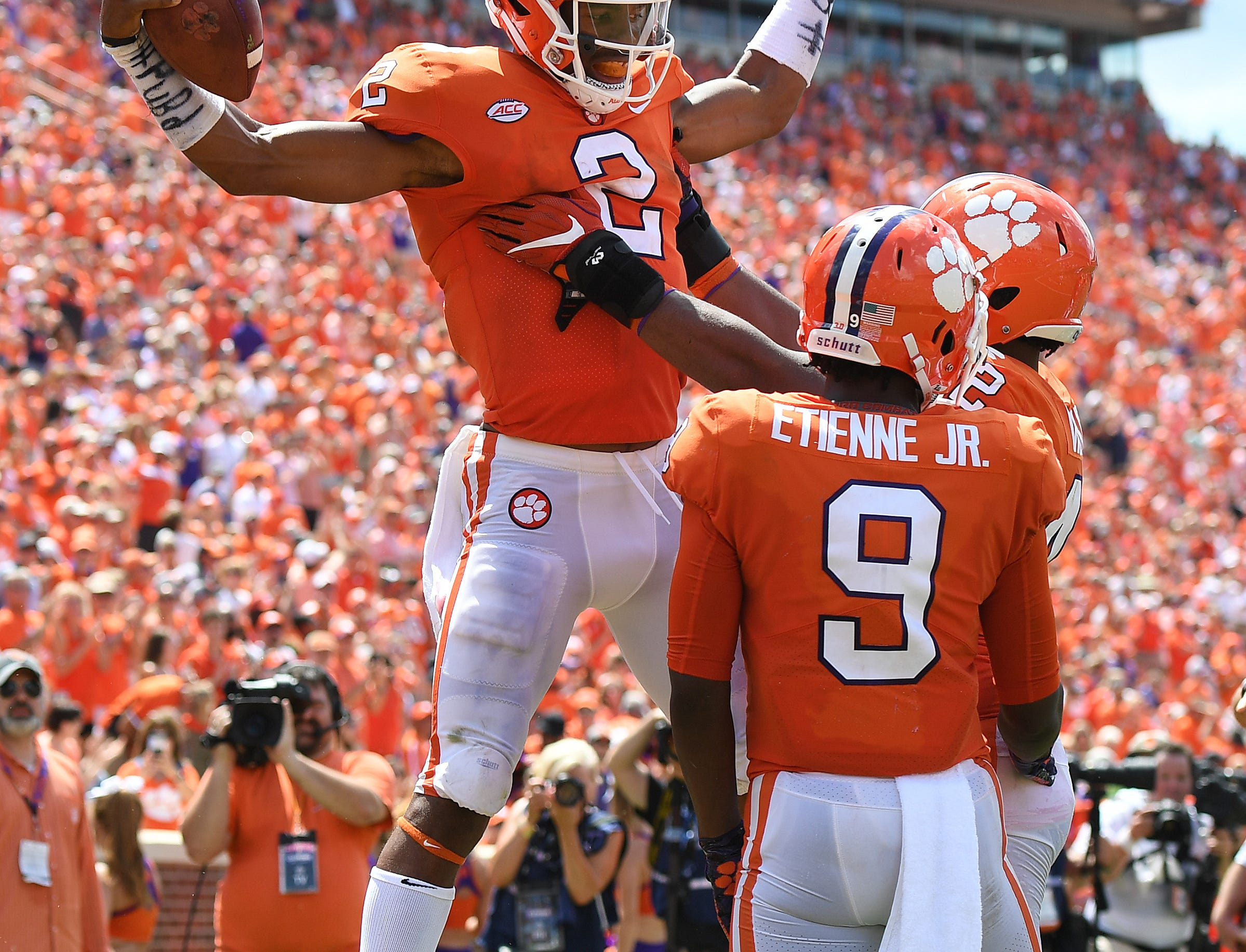 Clemson quarterback Kelly Bryant (2) celebrates with defensive lineman Christian Wilkins (42) and running back Travis Etienne (9) after scoring against Furman during the 3rd quarter Saturday, September 1, 2018 at Clemson's Memorial Stadium.