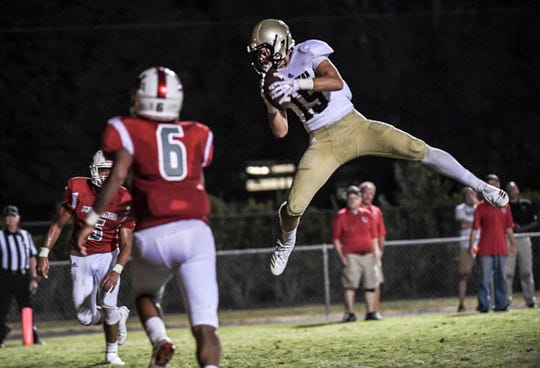 Pendleton senior Payton Bunch catches a pass for a touchdown against Palmetto during the fourth quarter at Palmetto High School in Williamston on Friday, August 24, 2018.