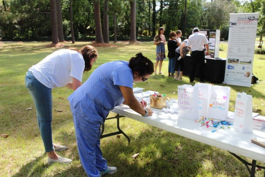 Melissa Socia (right) and Pam Socia decorate memorial bags for Jakelynn Ammons. Jakelynn was Melissa's daughter and Pam's niece. She died from a carfentanil-related overdose in January, and a woman who allegedly sold the drug to her is facing a second-degree murder charge.