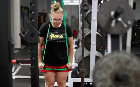 Danielle Eaglin works on tricep pushdowns in the Neenah High School weight room. Danny Damiani/USA TODAY NETWORK-Wisconsin