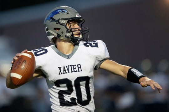 Xavier's TJ Van Eperen passes against Menasha during Friday's game.   Dan Powers/USA TODAY NETWORK-Wisconsin