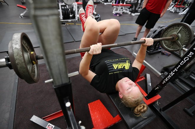 Danielle Eaglin, a senior at Neenah High School, works out with other members of the Neenah powerlifting team Wednesday. Eaglin was selected to compete in the World Sub-Junior Powerlifting Championships in Potchefstroom, South Africa. Danny Damiani/USA TODAY NETWORK-Wisconsin