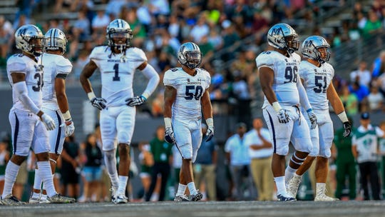The Monmouth University defense lines up against Eastern Michigan on Friday night.