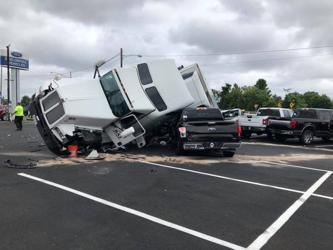 A tractor-trailer truck slammed into Tom's Ford dealership on Route 35 in Keyport on Friday.