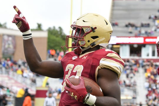 Jon Hilliman (32) celebrates after scoring a touchdown for Boston College in 2017.