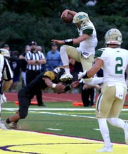 Red Bank Catholic quarterback Steve Lubischer jumps into the endzone over a St. John Vianney defender during first half action in their game in Holmdel Friday night, August 31, 2018.