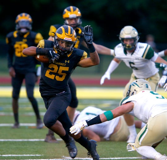 St. John Vianney's Kavon Chambers breaks downfield ahead of Red Bank Catholic defenders during first half action in their game in Holmdel Friday night, August 31, 2018.