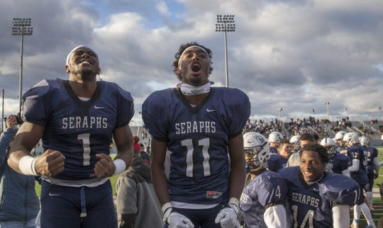 Mater Dei Prep's Marvin Pierre and Eddie Lewis (No. 11) celbrate with teammates after their last minute win over Holy Spirit in the 2016 NJSIAA Non-Public Group II Championship.