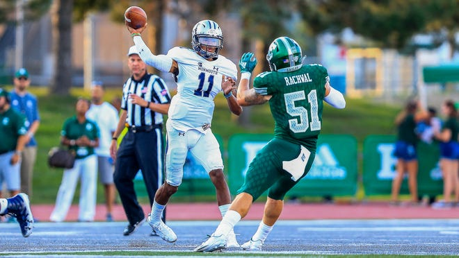 Monmouth quarterback Kenji Bahar throws a pass in the first half against Eastern Michigan.