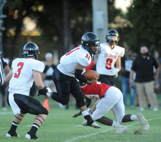 Colorado City quarterback Markis Monroe (11) breaks a tackle against Albany at Robert Nail Memorial Stadium on Aug. 31, 2018. The Wolves went on to win 32-13.