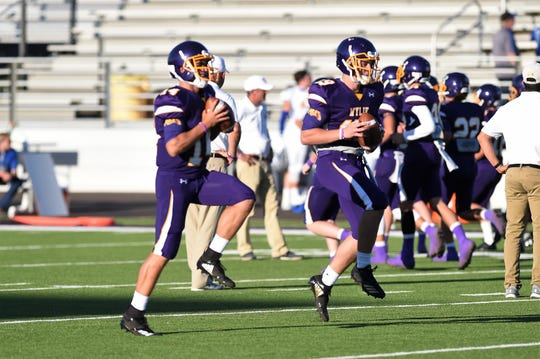 Wylie quarterbacks Jaxon Hansen (14) and Harrison Atwood (19) warm up before the Bulldogs opened the season against Georgetown.