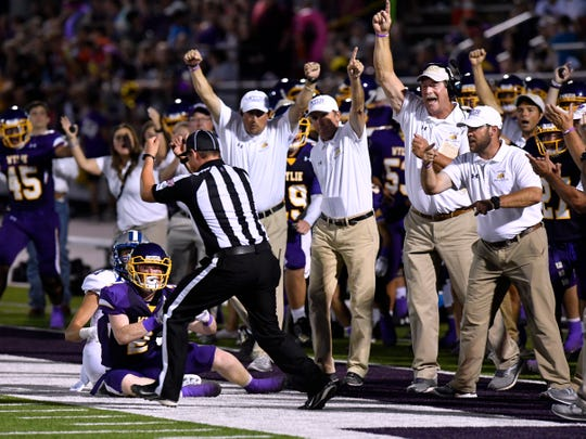 Wylie High School coaches react as the official rules the Bulldogs' Gus Davis interception of a pass meant for Georgetown's Noah Drum as good, turning the ball over to Wylie Friday August 31, 2018. Final score of the game was 31-7, Georgetown.