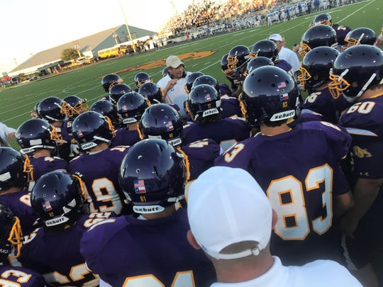Wylie coach Hugh Sandifer talks to his players before the start of their game against Georgetown.