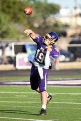 Wylie quarterback Harrison Atwood (19) lets a throw go before the Bulldogs opened the season against Georgetown.