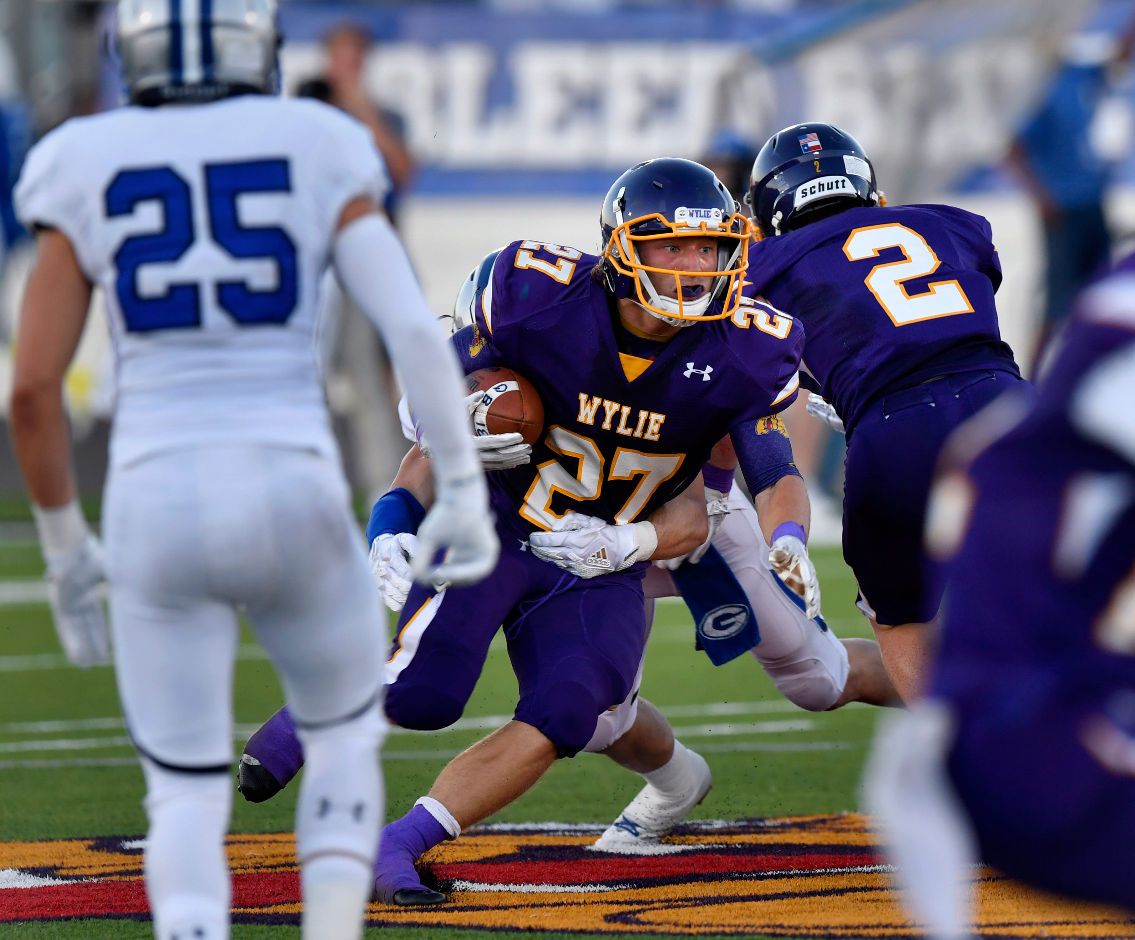 Wylie's Bailey Hicks runs up the middle during Friday's game against Georgetown. The Bulldogs lost the season opener 31-7.