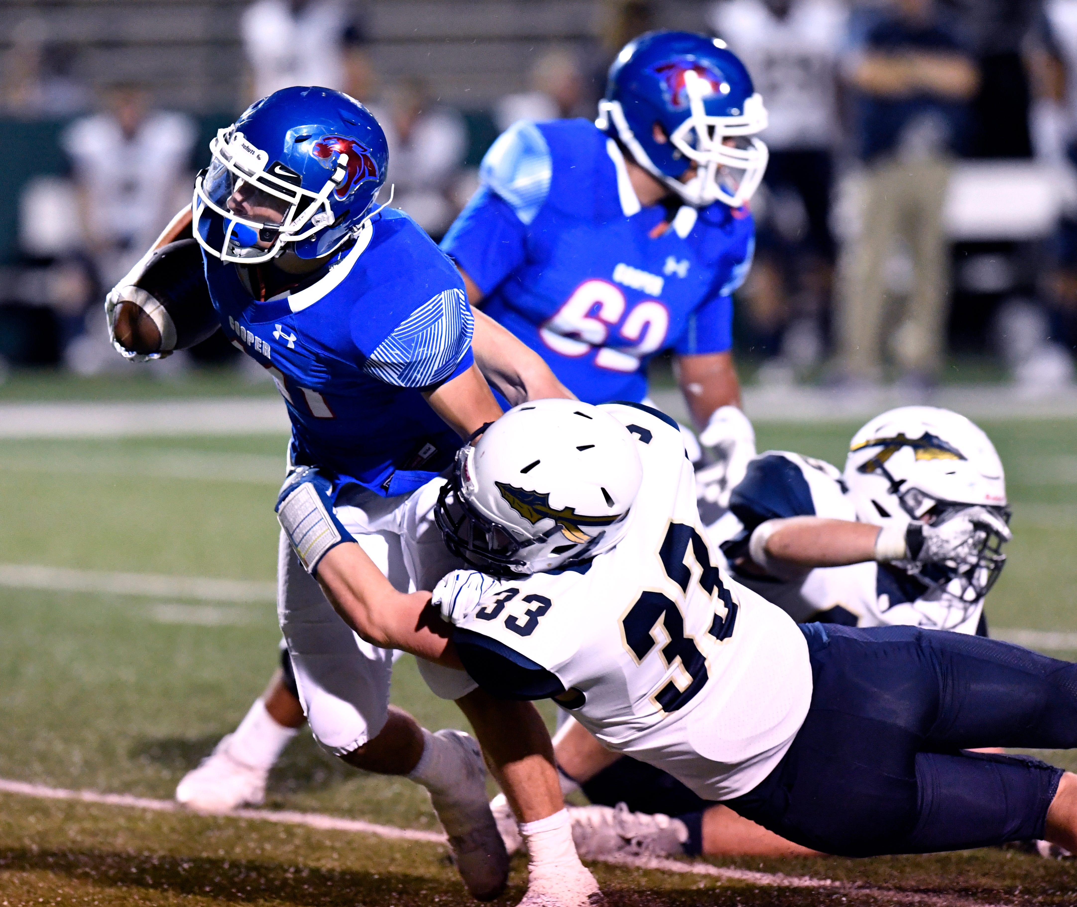Cougars' running back Nic Bailey is tackled by Keller's Conner Medlock during Friday's game at Shotwell Stadium. It was Bailey's first game with the Cooper varsity.