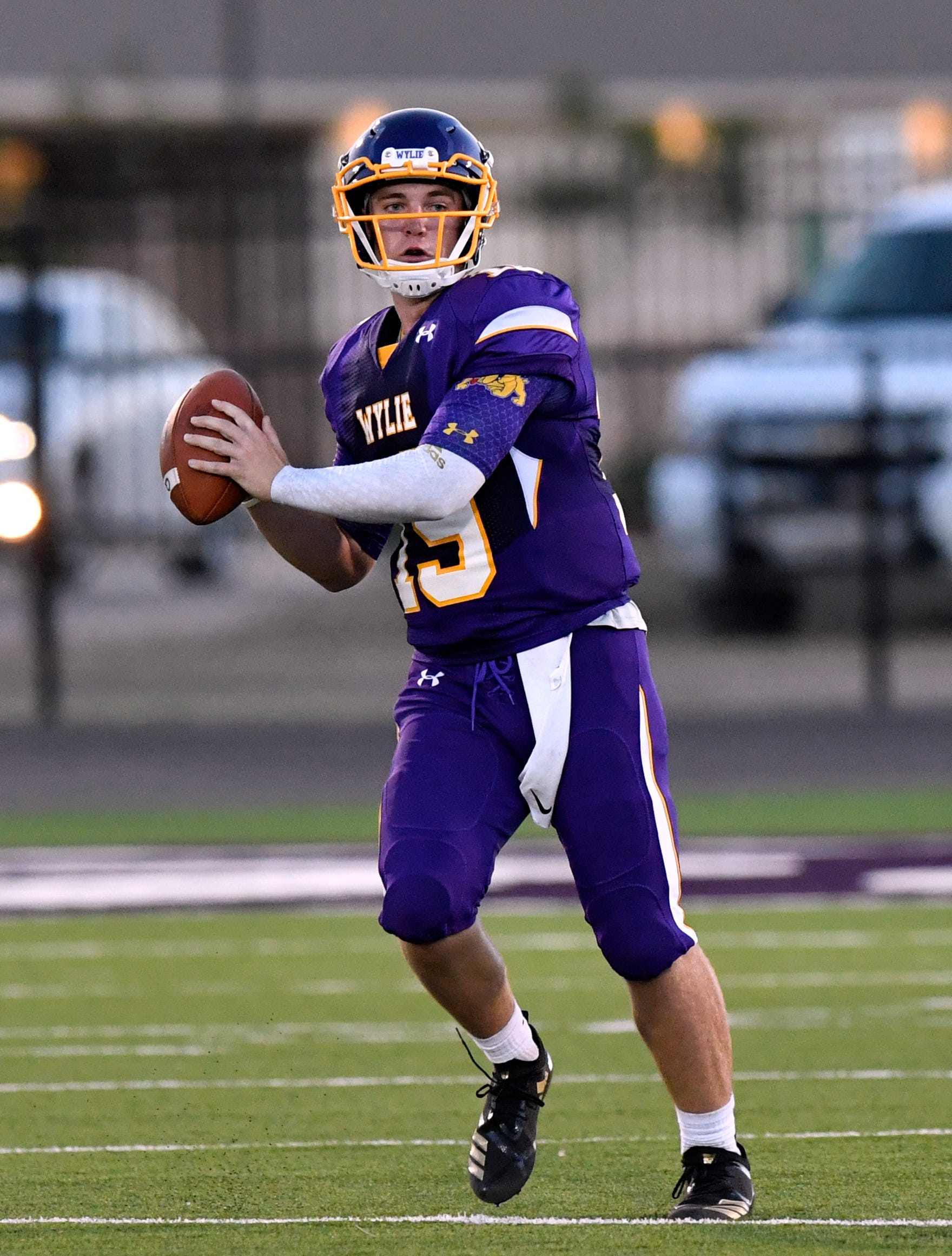 Bulldogs quarterback Harrison Atwood looks for a receiver during Wylie's game against Georgetown.