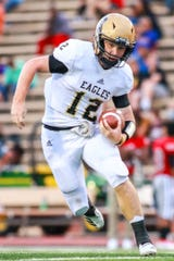 Abilene High quarterback Eric Abbe gains yards in the first quarter of Friday's game against Tascoa in Amarillo. Abbe scored the Eagles' only touchdown but was knocked out of the game with an injury.
