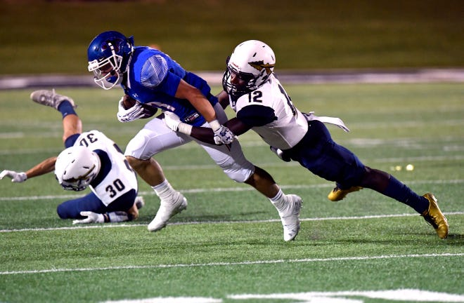 Cooper running back Nic Bailey is tackled by Keller's Dalton Winston during Friday's game at Shotwell Stadium August 31, 2018. Final score was 41-15, Keller.