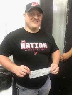 Gage Norris won over $21,000 in the 50/50 raffle at the Pisgah-Tuscola game Friday night.