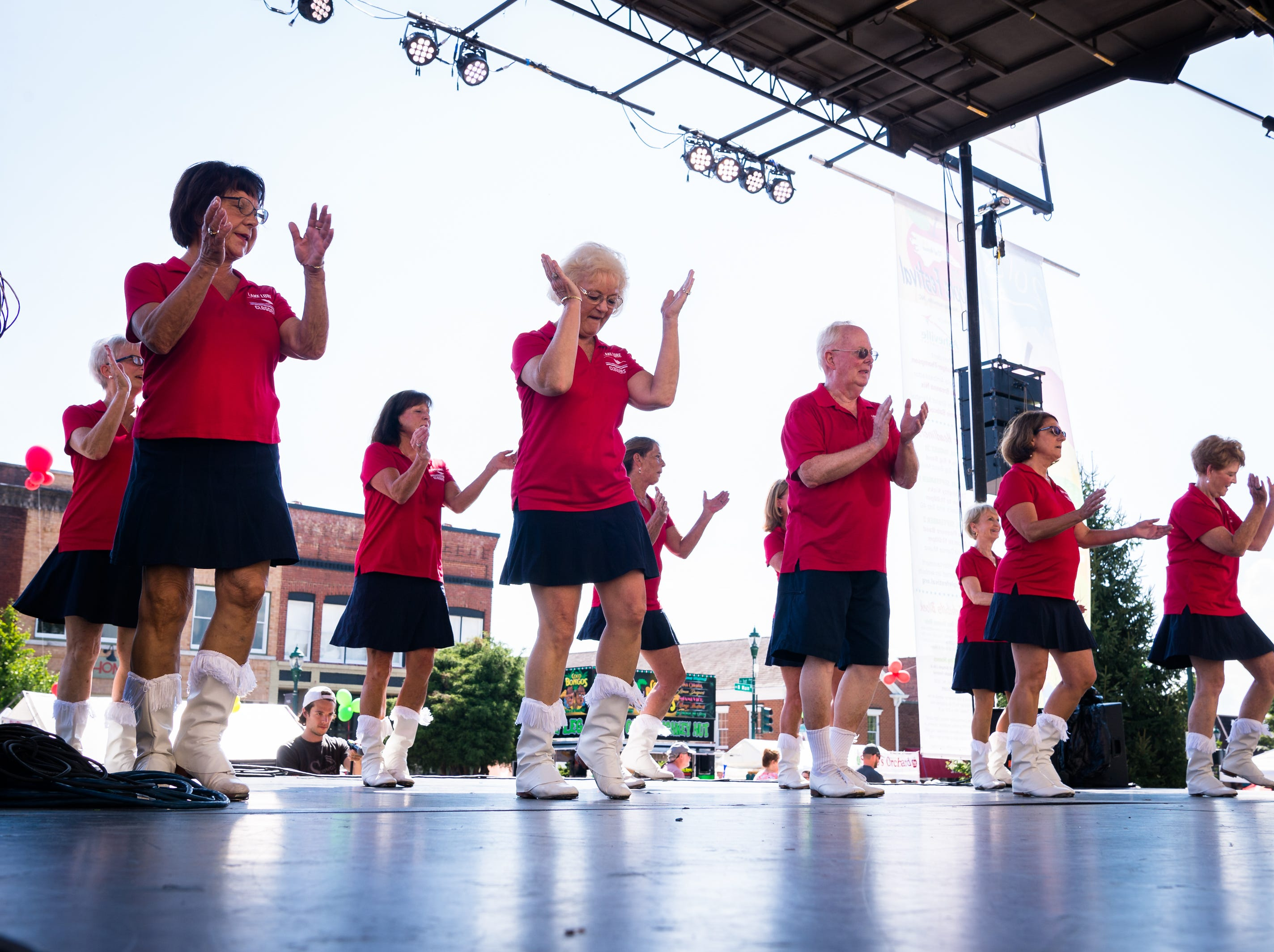 The Lake Lure Cloggers perform on stage in front of Hendersonville's historic court house at the 72nd annual North Carolina Apple Festival Saturday, September 1, 2018.
